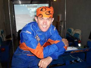 Pro Sim Driver Kevin A wearing a Scott Dixon designed bandana in support of the fund raising campaign with Kids CanTeen.