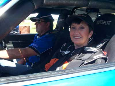 Rookie navigator, Pit Babe Gran, SimDeck Staffer and my mum, all strapped in for some high speed hot laps on the Puke Circuit in the Targa Race car.
